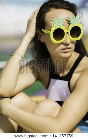 portrait of young woman with Pineapple's sunglasses
