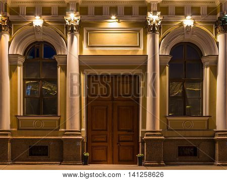 St. Petersburg Russia - May 30 2016: Door and two windows on nignt illuminated facade of N.I.Vavilov Institute of Plant Genetic Resourses front view
