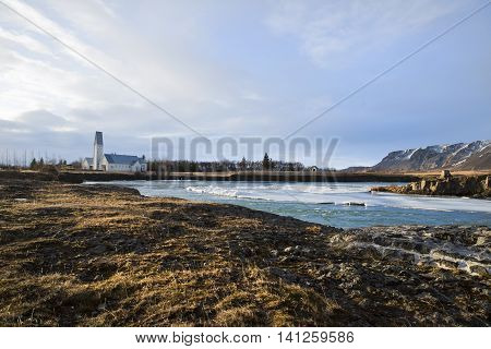 View of a church by a river at winter in Selfoss, Iceland 2014