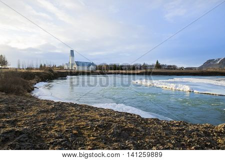 View of a church by a river in Selfoss, Iceland 2014
