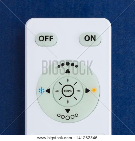 White remote control on the blue background