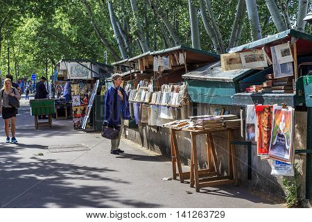PARIS, FRANCE - MAY 12, 2015: These are Parisian booksellers shops traditionally located on the quays of the left bank of the Seine.