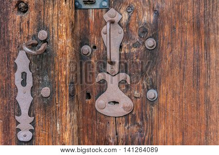 Wooden door of an old country cottage - detail close-up