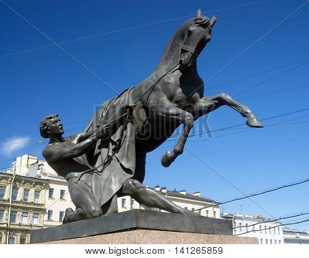 View of Horse tamers monument by Peter Klodt on Anichkov Bridge in Saint-Petersburg Russia. Popular touristic landmark.