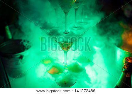 martini glasses pyramid with liquid nitrogen; beautiful catering bar;