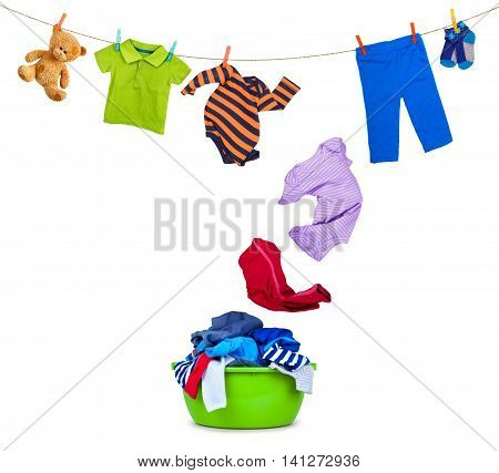clothing falls from laundry line in wash bowl on white background