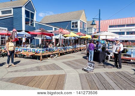 RICHMOND, CANADA - JULY 10: Visitors at the picturesque seaside village of Steveston in Richmond near Vancouver July 10, 2016. The popular Fisherman's Wharf is famous for fresh seafood, the many eateries and unique shops.