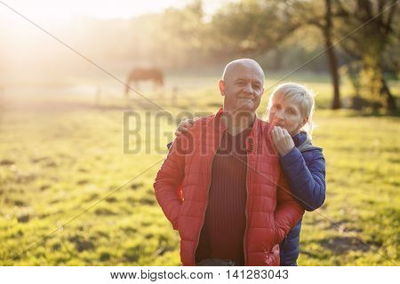 Happy Seniors Couple Embrace And Smile;