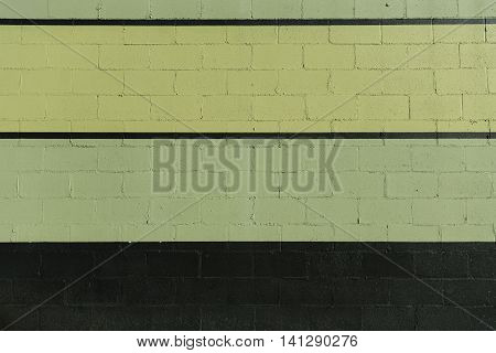 Green and Black Stripes on Cinder Block Wall exterior
