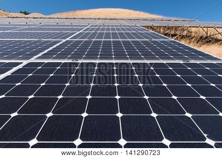 Solar Panels On A Hillside With Grass