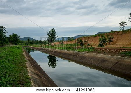 june 12-2016 Chiang Mai Thailand. The irrigation canal leads to the mountain.