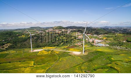Wind power plants on a green hills