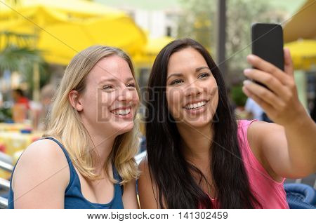 Happy Friends Taking A Self Portrait With Phone