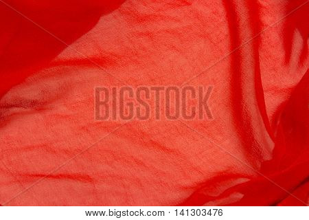 This is a closeup photograph of a Red sheer fabric
