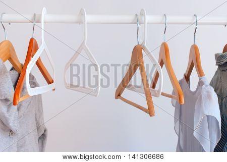 Pastel Female Cloth Open Rail Hanger Grey Wall