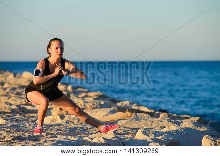 Young Sporty Girl Stretching On The Beach