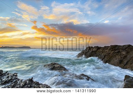 Currumbin Rock Gold Coast, stormy sunset with ocean tide rushing over the rocks