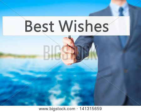 Best Wishes - Businessman Hand Holding Sign