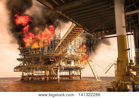 offshore oil and gas fire case or emergency case in warm picture style, firefighter operation to control fire on oil and gas production platform, offshore worst case and can't control fire
