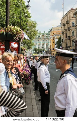 St. Petersburg, Russia - 31 July, The line of sailors along the street in the cordon, 31 July, 2016. Military sailors on parade in honor of the Navy.