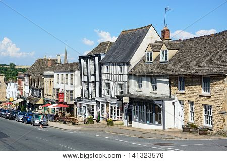 BURFORD, UNITED KINGDOM - JULY 20, 2016 - View of shops and businesses along The Hill shopping street during the Summertime Burford Cotswolds Oxfordshire England UK Western Europe, July 20, 2016.