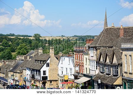 BURFORD, UNITED KINGDOM - JULY 20, 2016 - View of shops and businesses along The Hill shopping street during the Summertime Burford Oxfordshire England UK Western Europe, July 20, 2016.