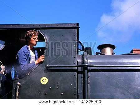 HIGHLEY, UNITED KINGDOM - JULY 18, 1993 - Engine driver in the cab of his steam locomotive Severn Valley Railway Highley Shropshire England UK Western Europe, July 18, 1993.