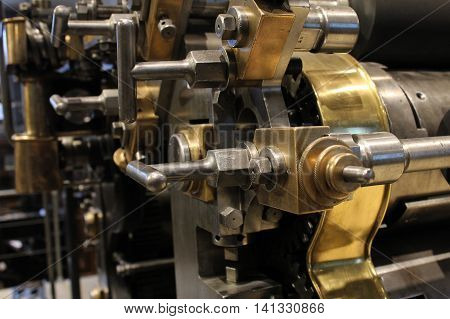 Old printing press mechanical gears - polygraphic equipment