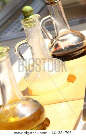 Olive oil lemon juice and pomegranate vinegar for salads
