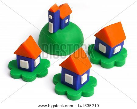 Plasticine model of a house - a small village on a white background