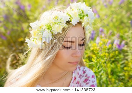 Young female with blond hair and flower coronet