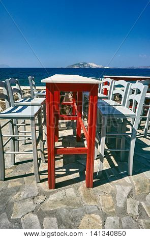Table and chairs Greek taverna on the seafront on the island of Nisiros