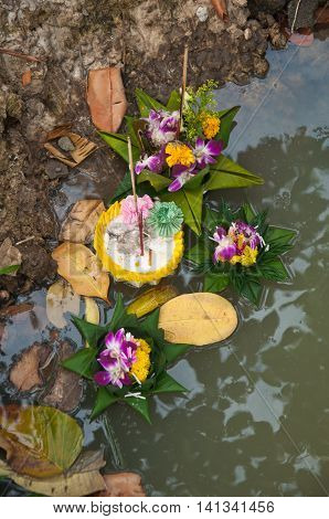 Lonely floating basket made from banana leaf in the canal loy krathong festival in Thailand.