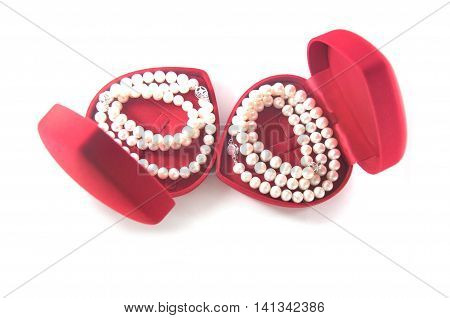 necklace of pearls in a heart shaped red box