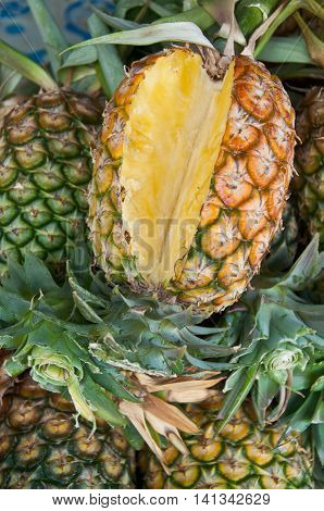 yellow pineapple fruit in market, fresh fruit