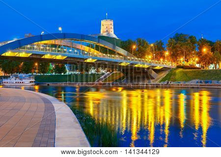 Night Gediminas Tower and King Mindaugas Bridge across Neris River in the city Vilnius, Lithuania, Baltic states.