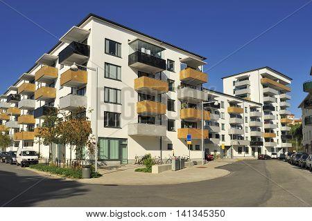 Swedish apartment Block with blue sky .