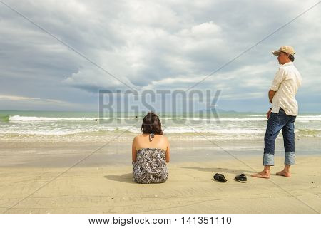 Man And Woman Looking At Sea At China Beach Danang