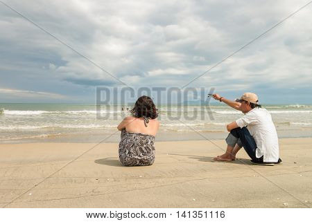 Man And Woman Looking Into Sea At China Beach Danang