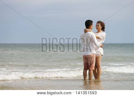 Young Couple Embracing Each Other In China Beach In Danang