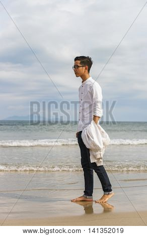 Young Fellow In China Beach Of Danang In Vietnam
