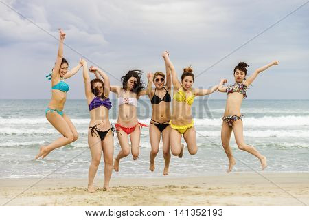 Young Girls Jumping At China Beach In Danang Vietnam