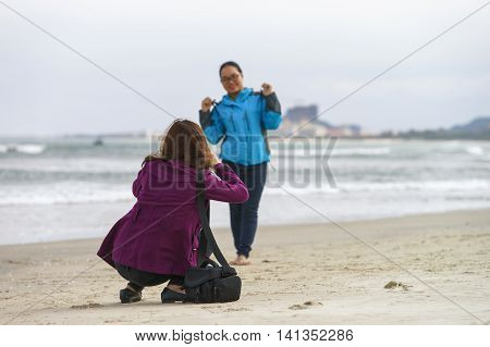 Young Girls Taking Photos In China Beach Danang
