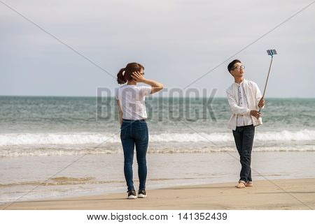 Young People Using Selfie Stick China Beach In Danang