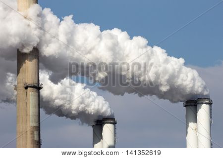 Brown coal smoke emission from two factory pipes