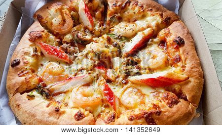 Pizza with seafood delicious in delivery box