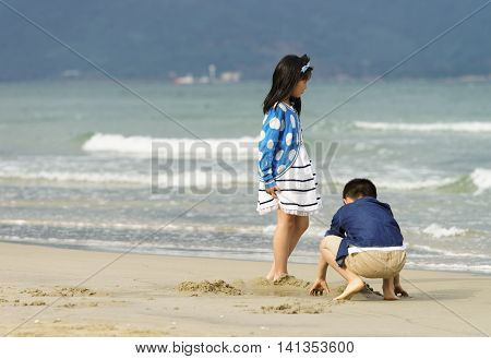 Small Children Playing At The China Beach In Danang Vietnam