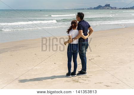 Young Couple Looking At Sea In China Beach In Danang