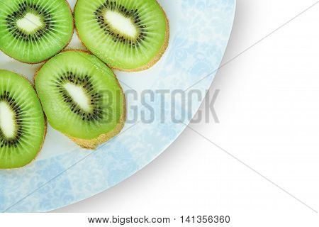 Kiwi fruit sliced on a plate. Space for messages