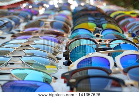 Replica sunglass rows at sunday market stall